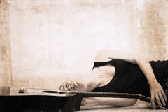 Artwork  in grunge style,  girl and guitar Stock Photography