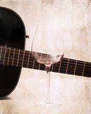 Artwork  in grunge style,  guitar and empty glass Stock Photos