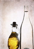 Artwork in grunge style,  olive oil and bottle of white wine Stock Image