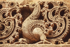 Artwork on the Hindu temple walls with friezes, mythical swans and designed patterns. India. Stock Photo