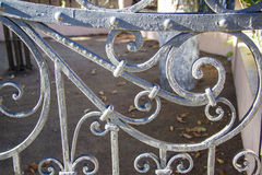 Artwork Iron Fence. Rust and chipping paint add grungy detail to this old wrought iron gate stock images