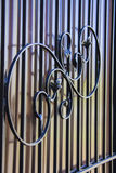 Artwork Iron Fence. Rust and chipping paint add grungy detail to this old wrought iron gate royalty free stock image