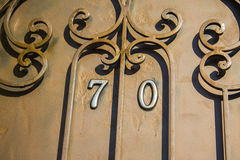 Artwork Iron Fence. Rust and chipping paint add grungy detail to this old wrought iron gate stock image