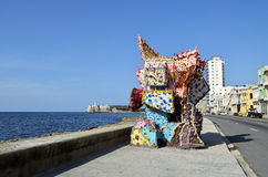 Artwork in the malecon (Havana, Cuba). Havana, Cuba - August 31, 2015: View of the coastline of Havana (Cuba), know as malecon, with a pinky artwork in the Stock Image
