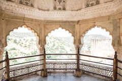 Artwork Masterpiece in Amber Fort. Beautifully architectured balcony inside Amber Fort overlooking the lush green Aravalli hill range in Jaipur, Rajasthan. The Stock Image