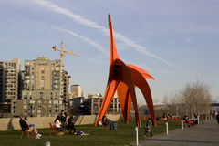 Olympic Sculpture Park Seattle. Artwork at Olympic Sculpture Park Seattle. Early spring afternoon, people were relaxing and enjoying the arts and the nature Royalty Free Stock Photo