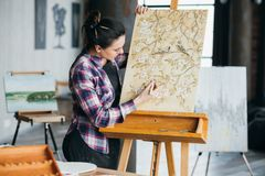 Artwork inspiration woman artist tool canvas easel. Artwork in process. Studio inspiration. Woman artist with tool creating. Canvas on easel. Flowers and birds royalty free stock image
