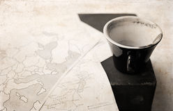 Artwork in retro style, empty cup of coffee and political map of Stock Photos