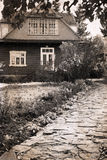 Artwork  in retro style,  old house in the country Stock Image
