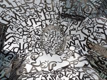 Artwork sculpture representing hope,beauty,unity and the symbolic nature of language by artist Jaume Plensa. BANGKOK, THAILAND. – On July 24, 2018 royalty free stock photos