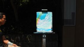 Artwork in Tokyo. Young artist creates beautiful pictures in minutes in Tokyo stock video