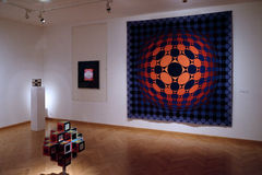 Artwork at the Vasarely Museum in Pecs Hungary. Abstract Tapestry and Three dimensional Artwork at the Vasarely Museum in Pecs Hungary Royalty Free Stock Photography