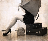 Artwork  in vintage style, woman waiting with luggage Royalty Free Stock Image