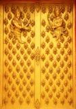 Artwork, wooden temple doors. Stock Photos