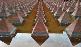 An arty hundred of pyramids in a water pond. Near government office, Mexico city stock images