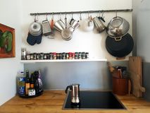 Arty kitchen in Iceland. Arty kitchen in a home in Iceland. Old recycled pipes used for hanging things up in the kitchen. This home is rented out via Airbnb and royalty free stock image