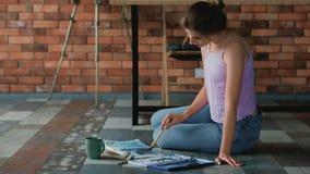Arty personality painter studio floor draw album