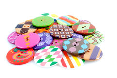 Arty pile of buttons. A pile of round colourful arty clothing buttons stock photo