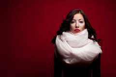 Arty portrait of a beautiful brunette with arty makeup and scarf. Arty portrait of a beautiful brunette with arty makeup and a vapory white silk scarf looking royalty free stock photos
