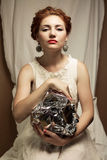 Arty portrait of fashionable queen-like ginger model Stock Images