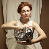 Arty portrait of fashionable queen-like ginger model Royalty Free Stock Photography