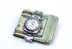 Artykuł wstępny: Luksusowy Rolex ogląda i pieniądze Zdjęcie Royalty Free