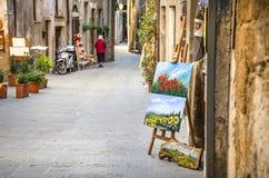 Artystów obrazki w Pitigliano wioski ulicach - Tuscany, Ita Fotografia Stock