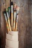 Artystów paintbrushes i rolka kanwa Zdjęcie Stock