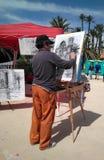 Artysta maluje obrazek w ulicie obrazy royalty free