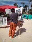 Artysta maluje obrazek w ulicie zdjęcie stock