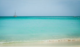 Aruba beach with boat on horizon. Aruban beach with waves and a boat on the horizon Royalty Free Stock Images