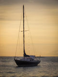 Aruba Coastal Sunset with gorgeous boat in foreground Royalty Free Stock Photography