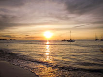 Aruba Coastal Sunset with gorgeous boat in foreground Royalty Free Stock Photos