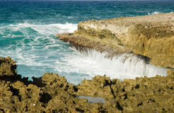 Aruba Coastline. Rocks and boulders at the base of a cliff . Aruba Coastline royalty free stock photo