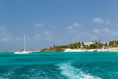 Aruba coastline. A view from sea back to the coast in Aruba in the Dutch Antilles Stock Image
