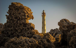 Aruba Image with California Lighthouse and Rocks in foreground Stock Photography