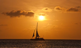 Aruba Sunset. Catamaran cruising in front of an Arubian sunset Stock Photos
