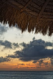 Aruba Sunset and Cabana. Colorful Aruba sunset from beneath a beach side cabana Stock Photo