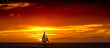 Aruba Sunset Katarmaran Sailing Past The Sun stock photography