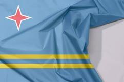 Aruba tkaniny flaga zagniecenie z biel przestrzenią i krepa obraz stock
