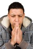 Aruban Mann ist denkend und betend Stockfoto