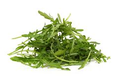 Arugula. Or rocket leaves, isolated on white royalty free stock photography