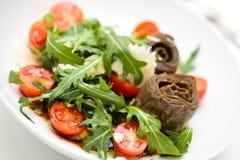 Arugula and artichoke salad. Royalty Free Stock Image
