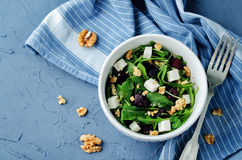 Arugula beet goat cheese walnuts salad Royalty Free Stock Image
