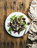 Arugula, beetroot, feta cheese and sunflower seed salad in plate Royalty Free Stock Photo