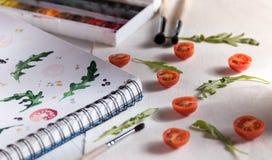 Arugula d'american national standard de tomates-cerises Photographie stock libre de droits