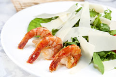 Arugula dish with shrimp. In a restaurant on the table royalty free stock image