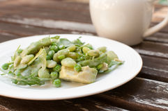 Arugula, green beans and avocado salad with dressing Stock Photo