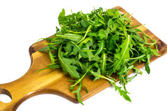 Arugula-ingredient salad on wooden Boards Royalty Free Stock Photo
