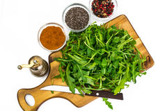 Arugula-ingredient salad on wooden Boards Royalty Free Stock Photography